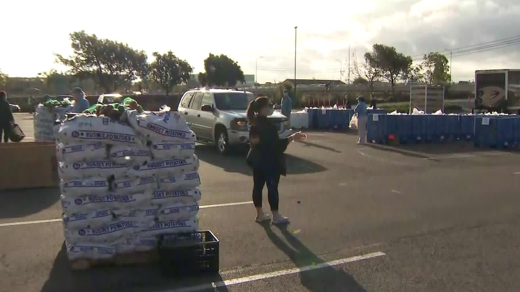 Volunteers hand out food at a drive-thru food bank at Honda Center on March, 21, 2020. (KTLA)