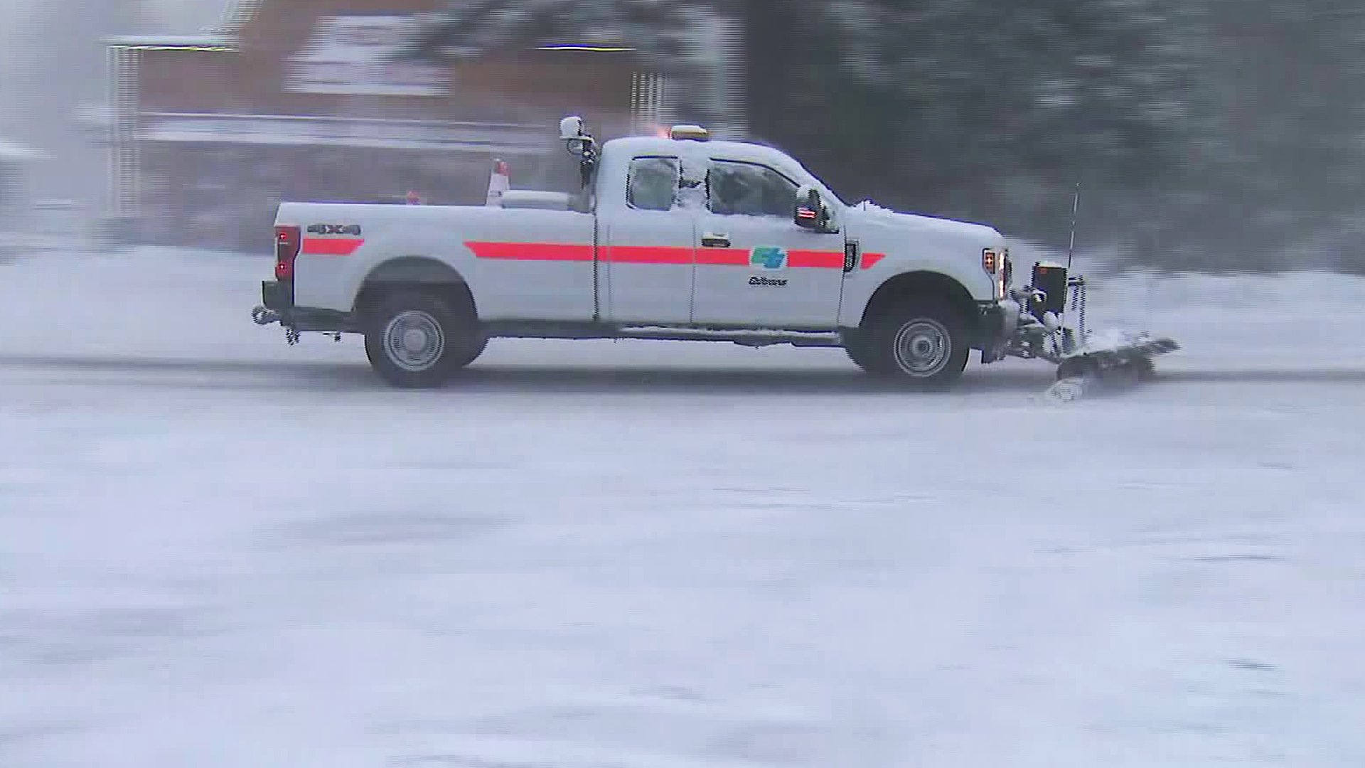 A truck plows the icy roads in Running Springs on March 2, 2020. (KTLA)
