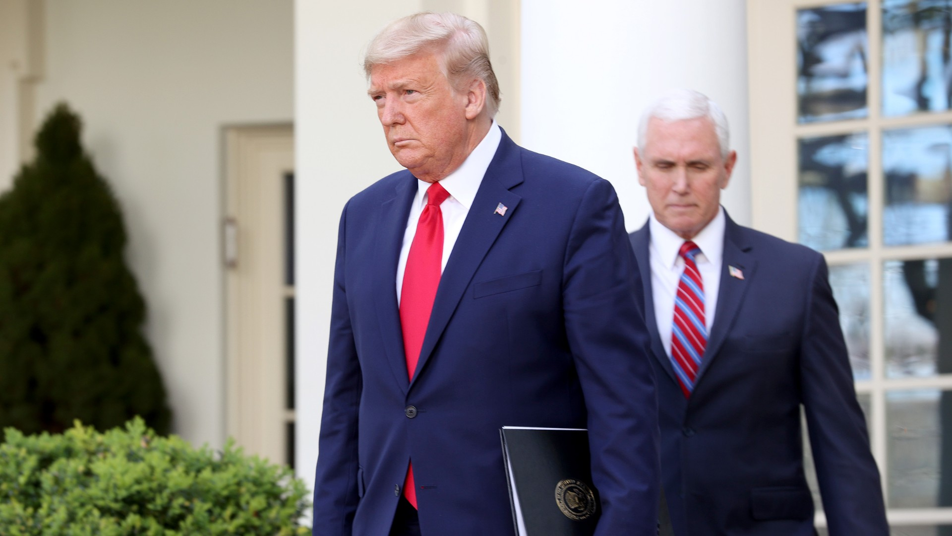 U.S. President Donald Trump and Vice president Mike Pence arrive for the daily coronavirus task force briefing at the Rose Garden of the White House on March 30, 2020 in Washington, DC. (Win McNamee/Getty Images)