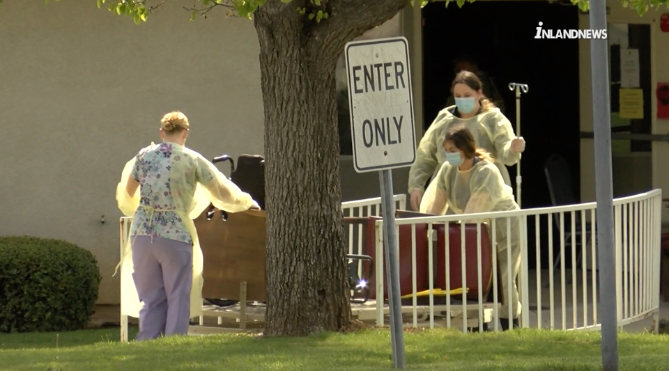 Staff remove wheelchairs from the Cedar Mountain Post Acute nursing home in Yucaipa after one death and 12 COVID-19 cases were confirmed among its residents on March 28, 2020. (Inland News)
