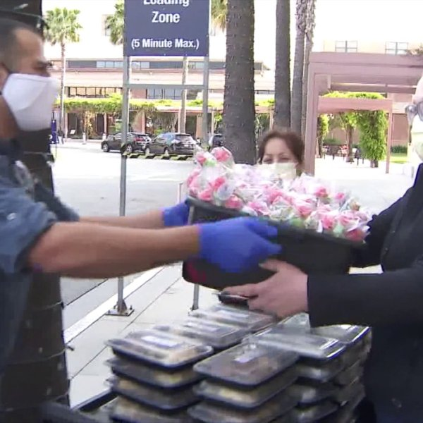Help Feed the Frontline delivers meals to hospitals workers at Adventist Health White Memorial Medical Center in Boyle Heights on April 2, 2020. (KTLA)