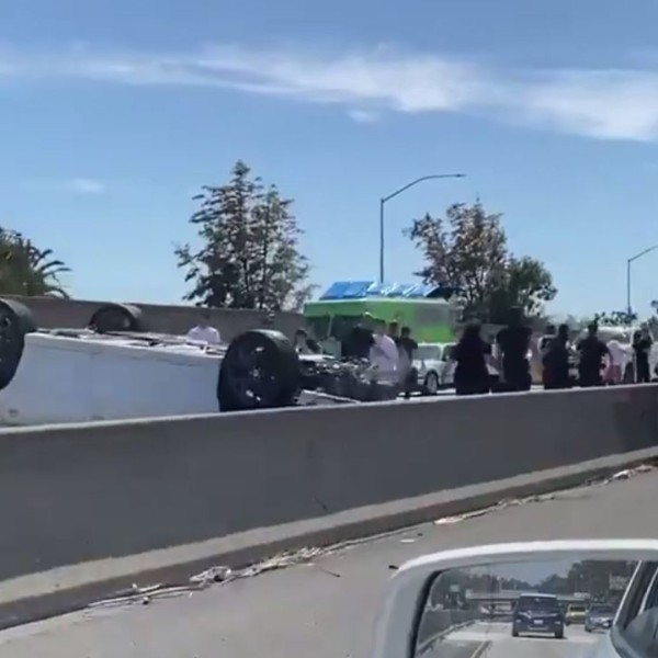 A person was killed in a rollover crash on the 10 Freeway in Los Angeles' Jefferson Park neighborhood on April 24, 2020. (Credit: Memo Torres)