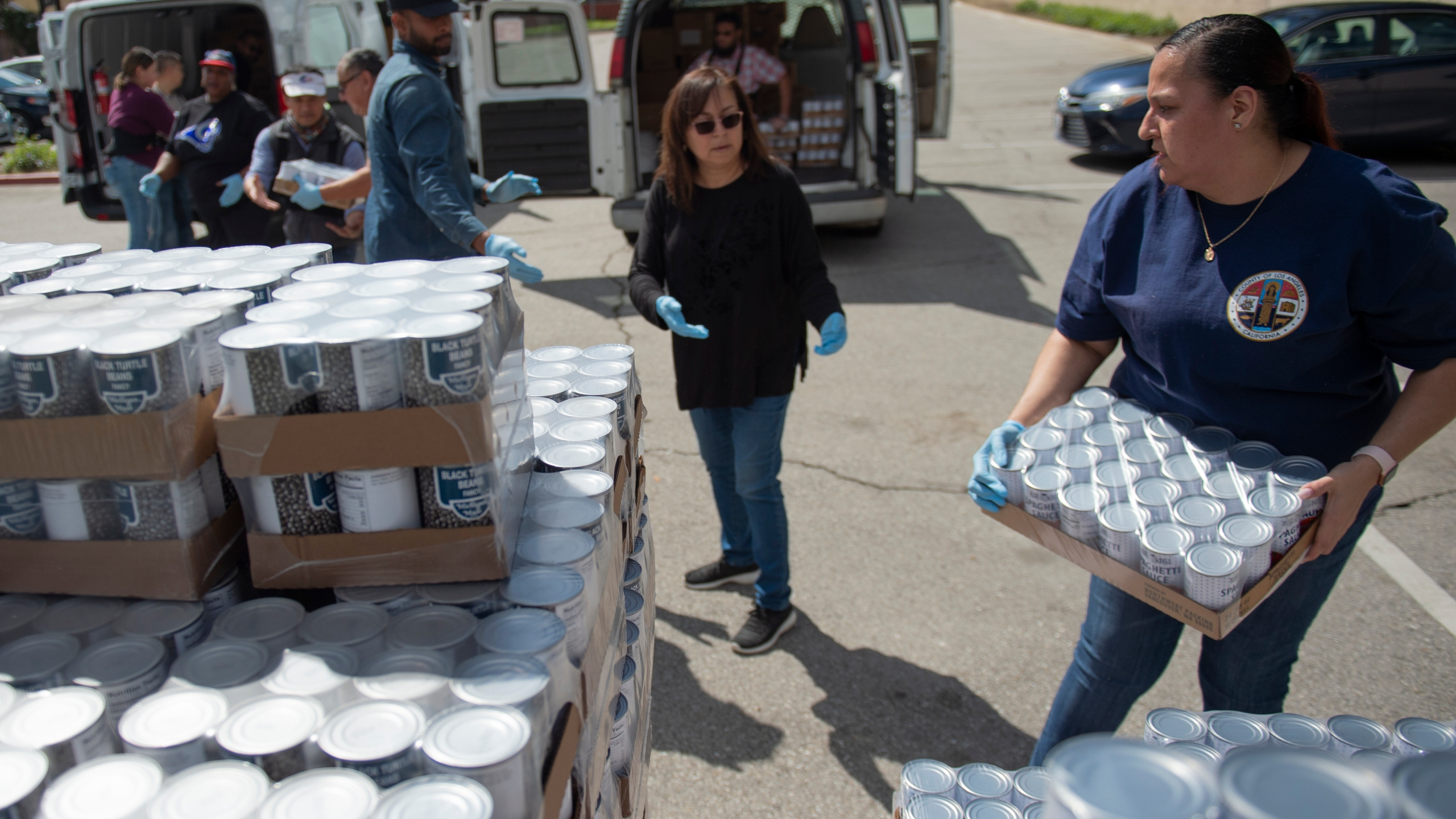 Crews with Los Angeles County handle food to be delivered to those in need during the COVID-19 outbreak in this photo posted on the county's Flickr page on March 23, 2020.
