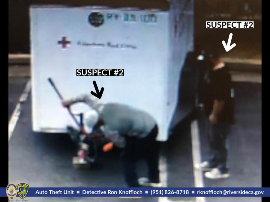A photo of two men captured stealing a  Red Cross trailer in Riverside was released by police on on April 1, 2020.