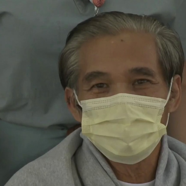 Tien Tran, 62, is seen outside Anaheim Global Medical Center after recovering from COVID-19 on April 20, 2020. (KTLA)