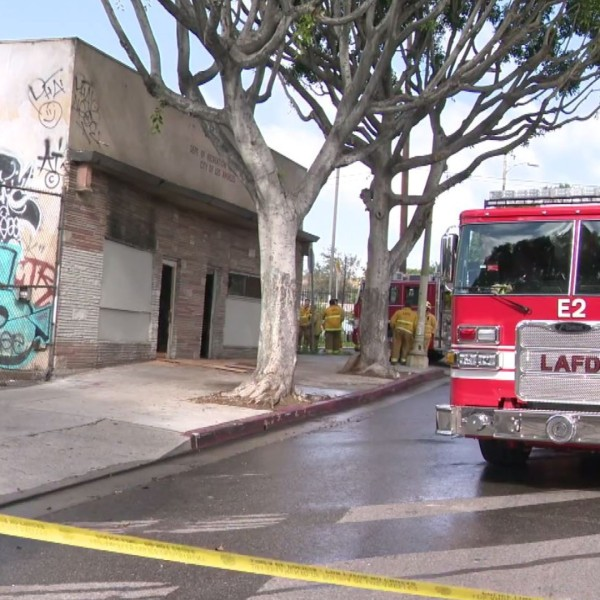 Los Angeles Fire Department firefighters work at the scene of a deadly commercial building fire in Boyle Heights on April 11, 2020. (KTLA)