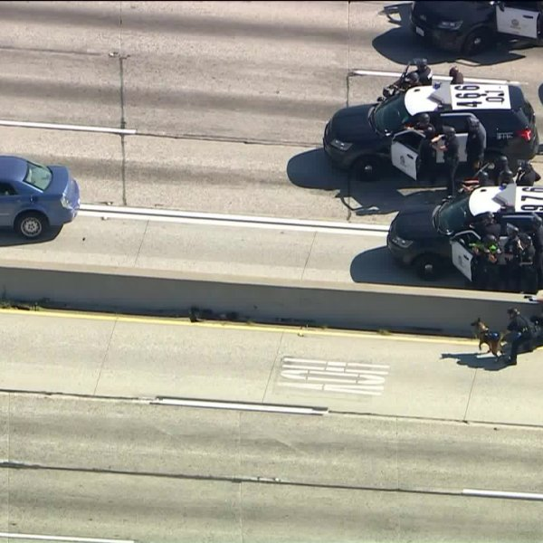 A man engaged in a standoff with authorities for more than an hour following a pursuit that ended on the 91 Freeway in Long Beach on April 22, 2020. (KTLA)