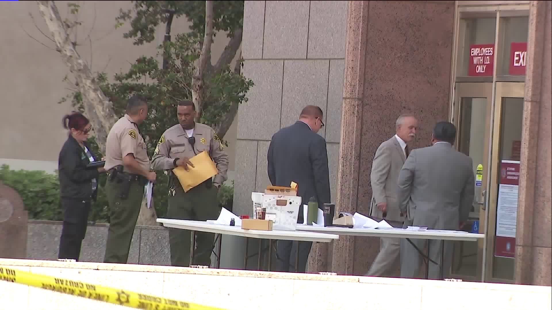 Detectives investigate the scene of where a deputy shot and wounded a hammer wielding man outside the Los Angeles County Superior Court's Van Nuys branch on April 3, 2020. (KTLA)