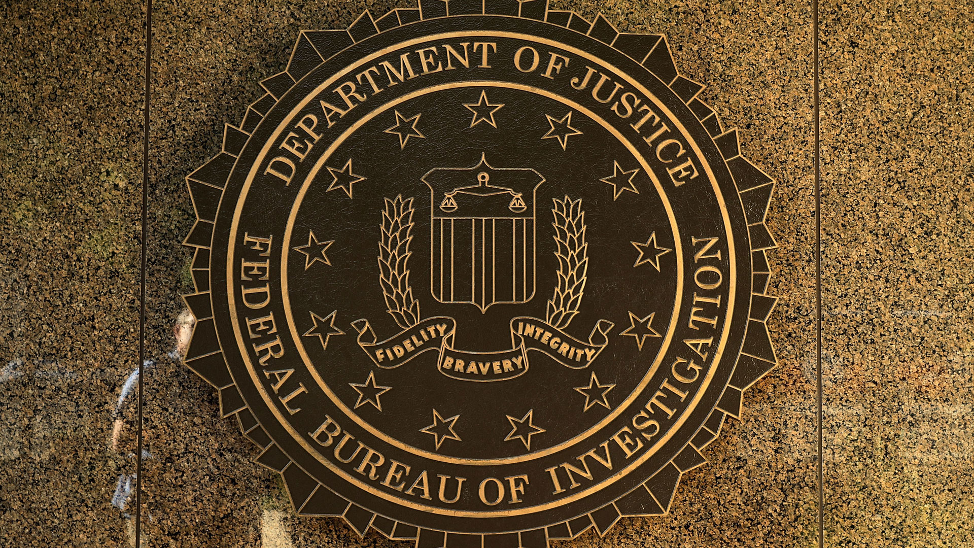 The seal of the Federal Bureau of Investigation hangs on the outside of the bureau's Edgar J. Hoover Building in Washington, D.C. (Photo by Chip Somodevilla/Getty Images)