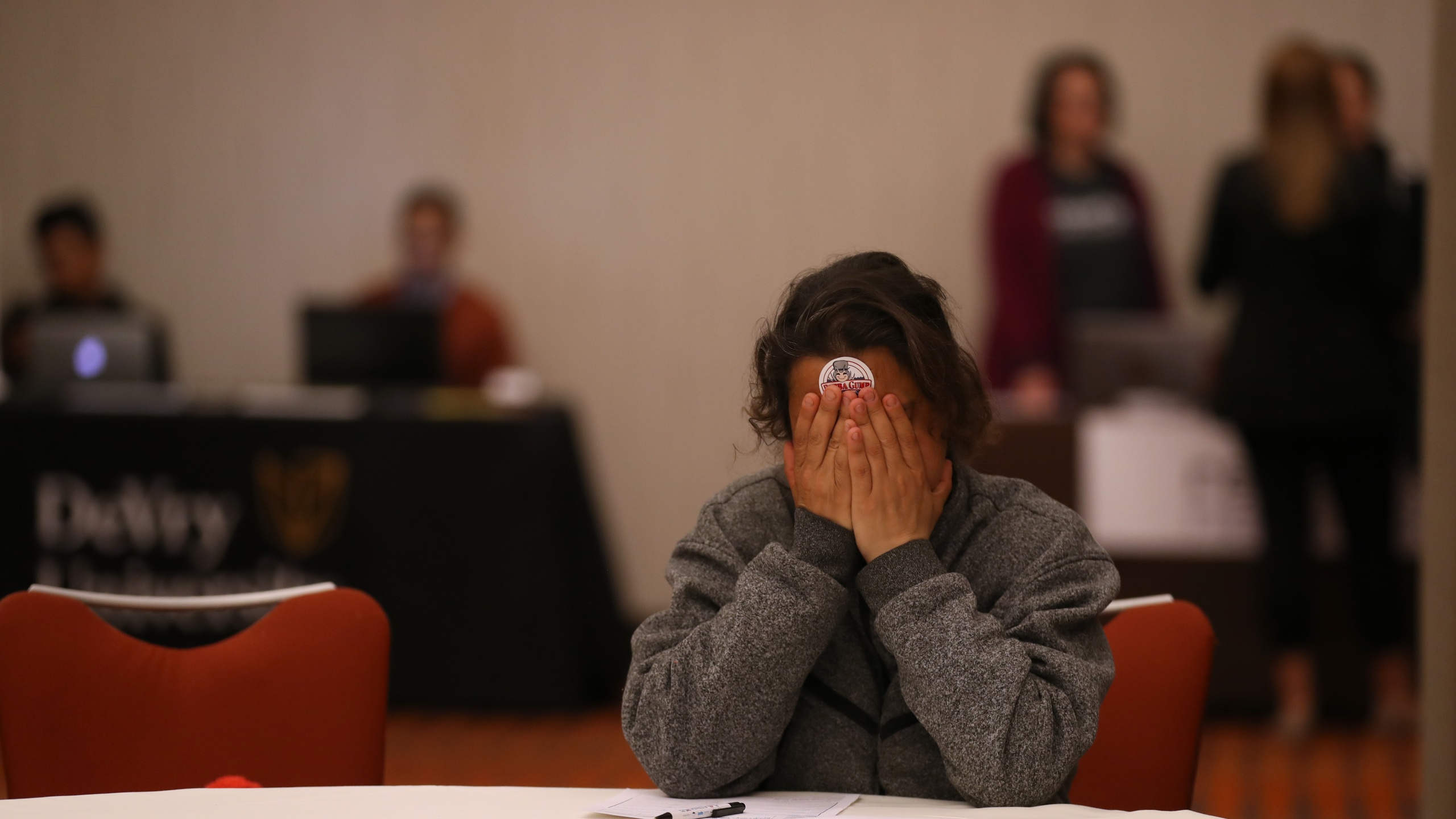 A job seeker pauses while filling out an application at the HireLive career fair on April 04, 2019 in San Francisco, California. (Justin Sullivan/Getty Images)