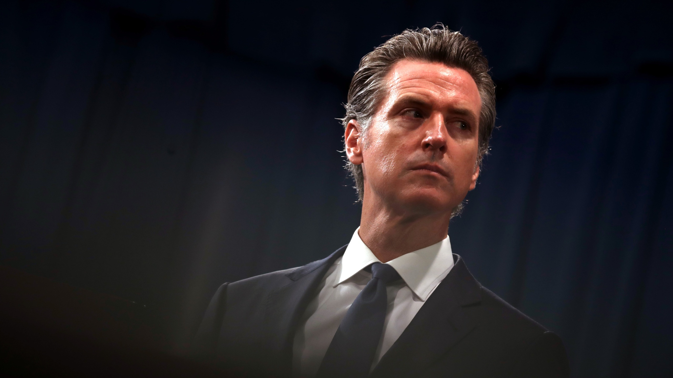 Gov. Gavin Newsom looks on during a news conference with California Attorney General Xavier Becerra in Sacramento on Aug. 16, 2019. (Justin Sullivan / Getty Images)