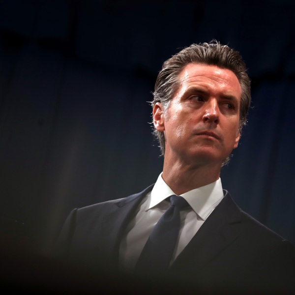 Gov. Gavin Newsom looks on during a news conference with California Attorney General Xavier Becerra at the California State Capitol on August 16, 2019 in Sacramento. (Justin Sullivan/Getty Images)