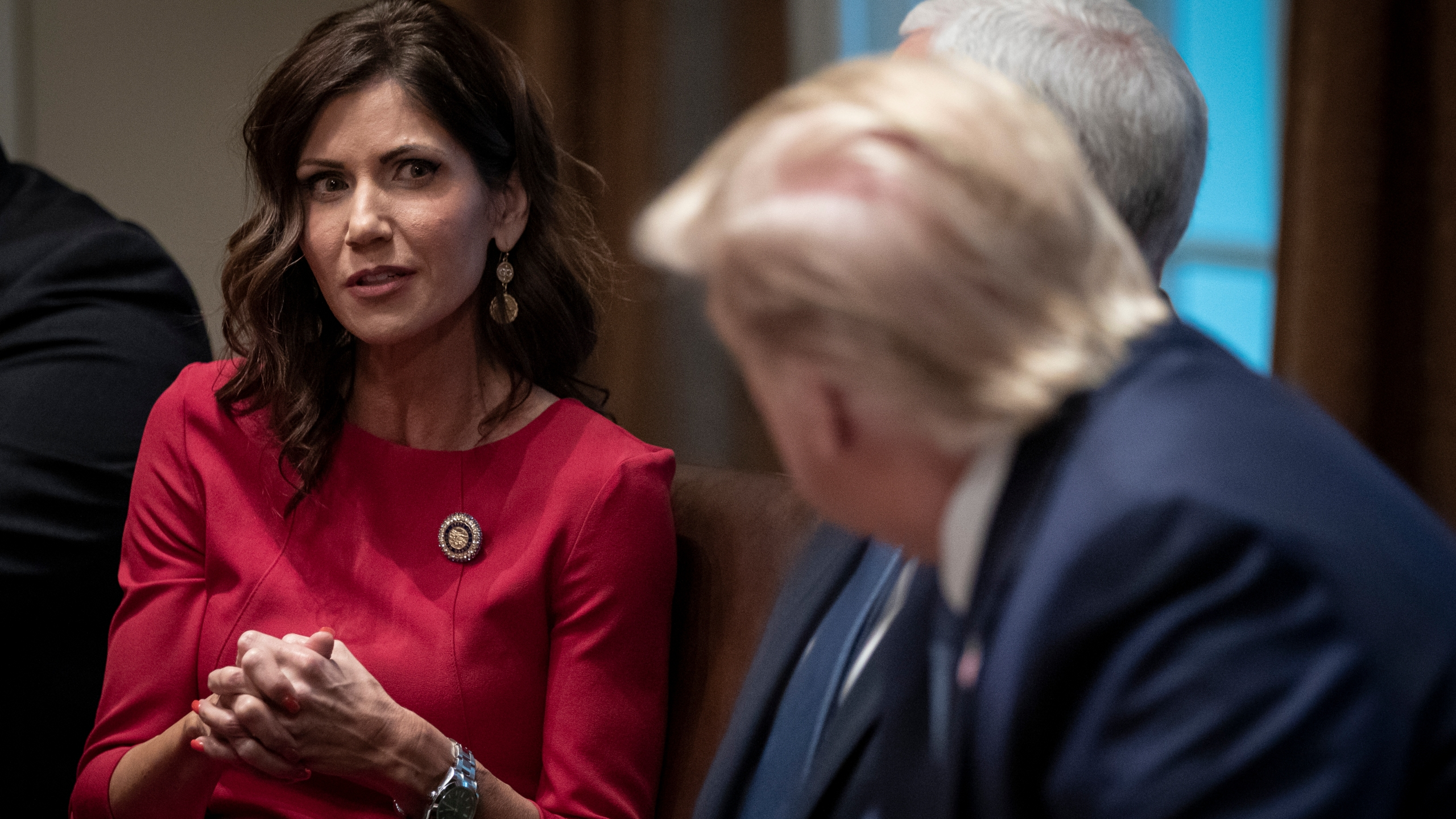 Gov. Kristi Noem of South Dakota speaks as U.S. President Donald Trump listens during a meeting about the Governors Initiative on Regulatory Innovation in the Cabinet Room of the White House on Dec. 16, 2019, in Washington, D.C. (Drew Angerer/Getty Images)