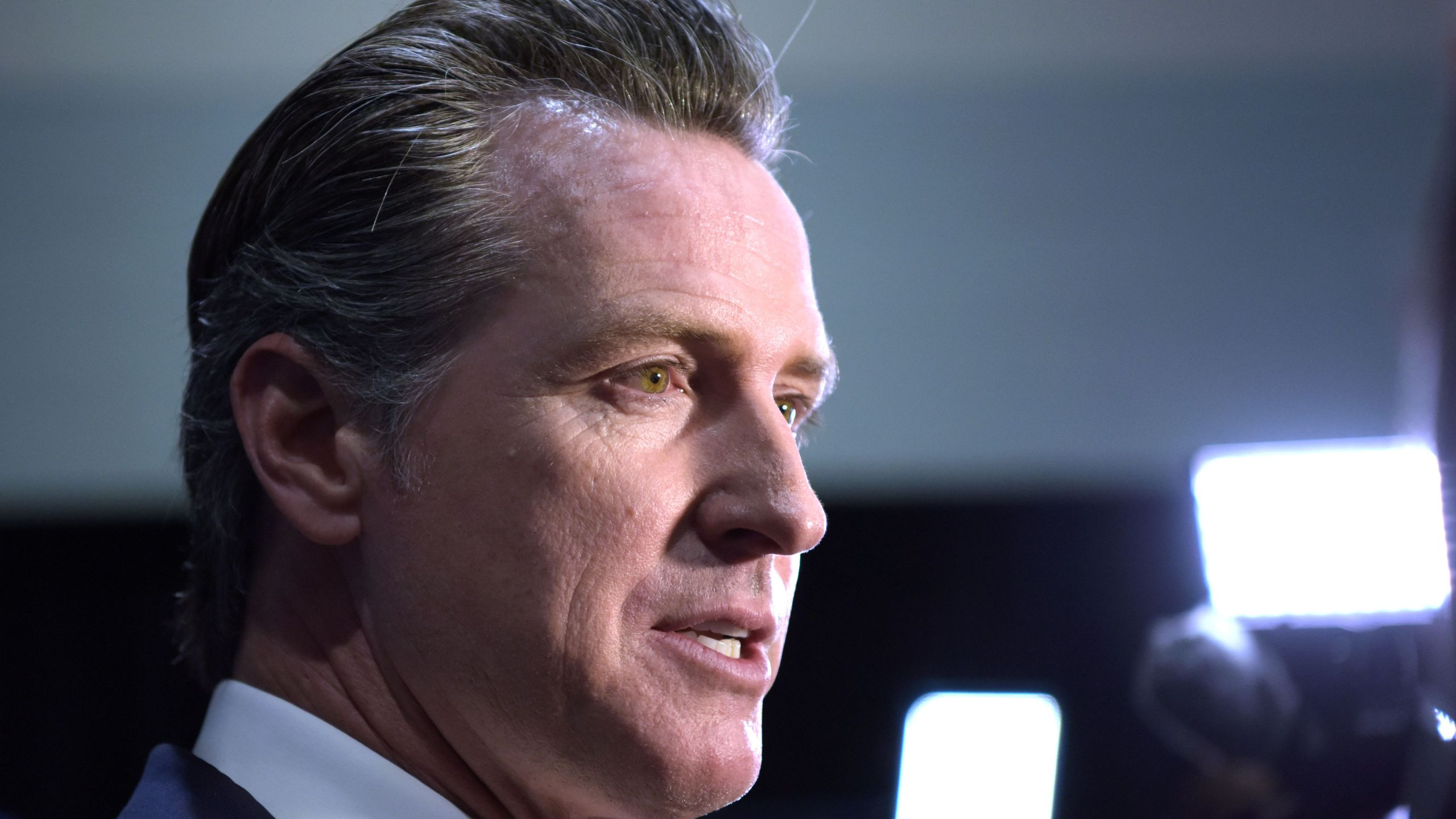 California Governor Gavin Newsom speaks to the press in the spin room at Loyola Marymount University in Los Angeles on Dec. 19, 2019. (AGUSTIN PAULLIER/AFP via Getty Images)