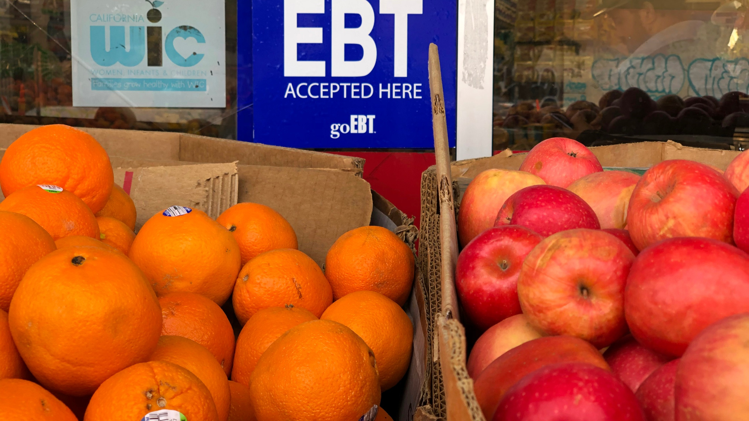 A sign noting the acceptance of electronic benefit transfer (EBT) cards that are used by state welfare departments to issue benefits is displayed at a grocery store on Dec. 4, 2019, in Oakland, Calif. (Justin Sullivan/Getty Images)