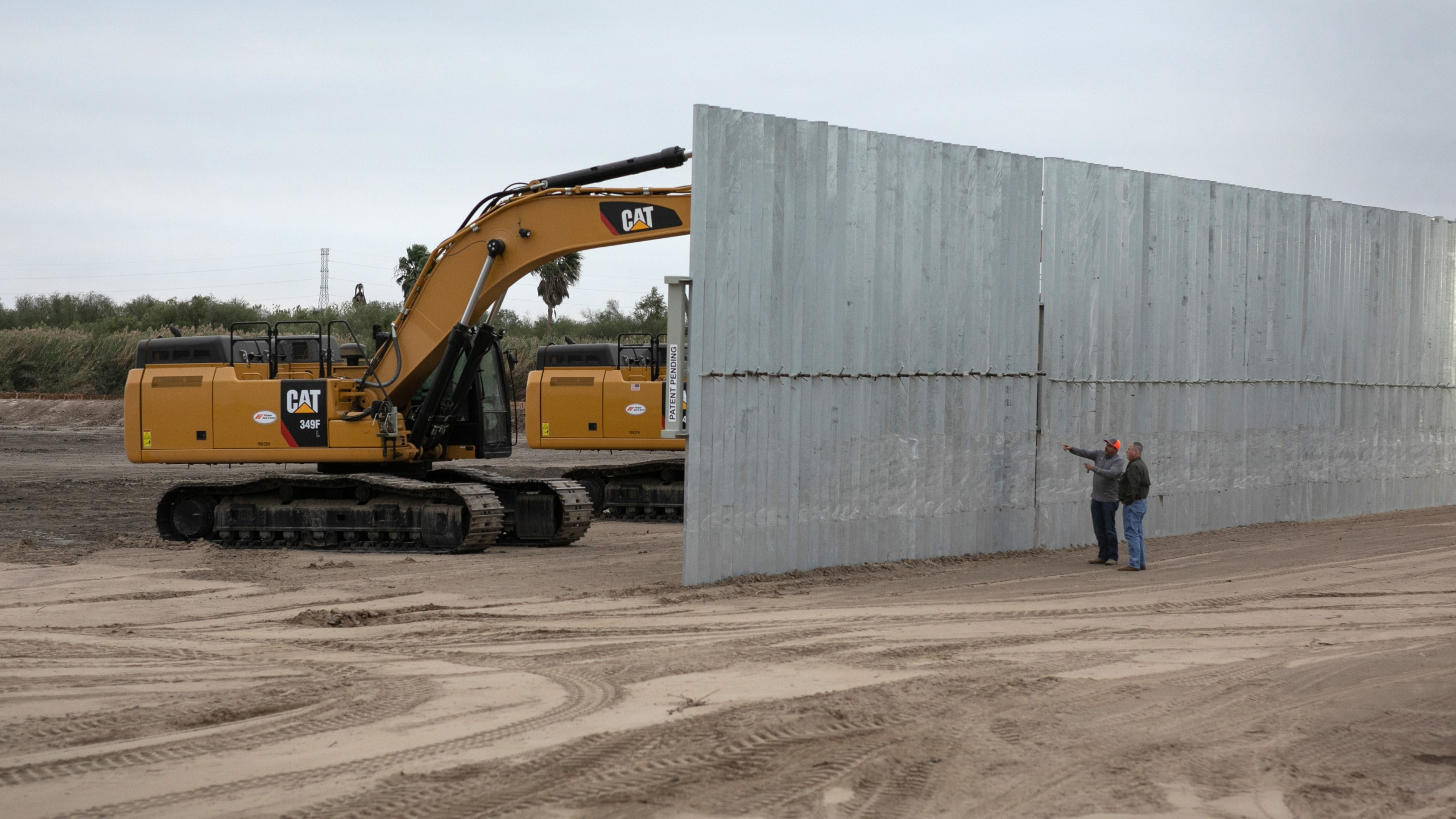 A construction crew works on a section of privately built border wall on Dec. 11, 2019, near Mission, Texas. (Photo by (John Moore/Getty Images)