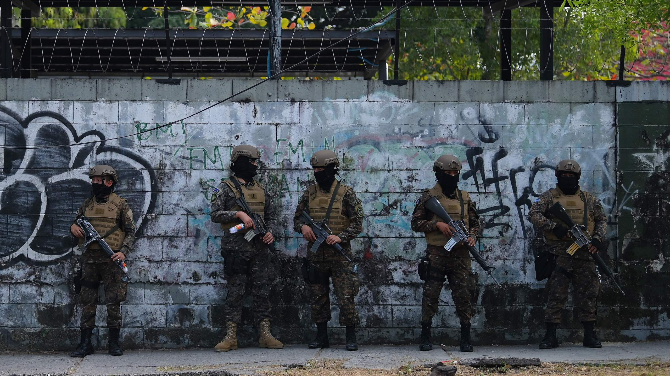 In this picture taken on February 09, 2020, soldiers guard the Legislative Assembly, in San Salvador, as supporters of Salvadoran President Nayib Bukele gather outside it to make pressure on deputies to approve a loan to invest in security. (MARVIN RECINOS/AFP via Getty Images)