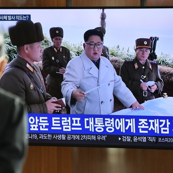 A man watches a television news broadcast showing file footage of North Korea's leader Kim Jong Un at a railway station in Seoul, South Korea, on March 9, 2020. (Credit: by Jung Yeon-je / AFP / Getty Images)