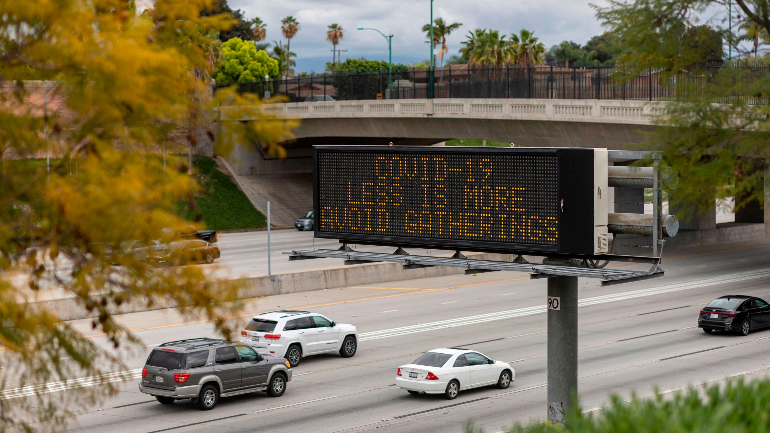 A Caltrans sign warns motorists on the 5 Freeway in Anaheim to not gather in crowds as the threat of coronavirus disease increases on March 14, 2020. (DAVID MCNEW/AFP via Getty Images)