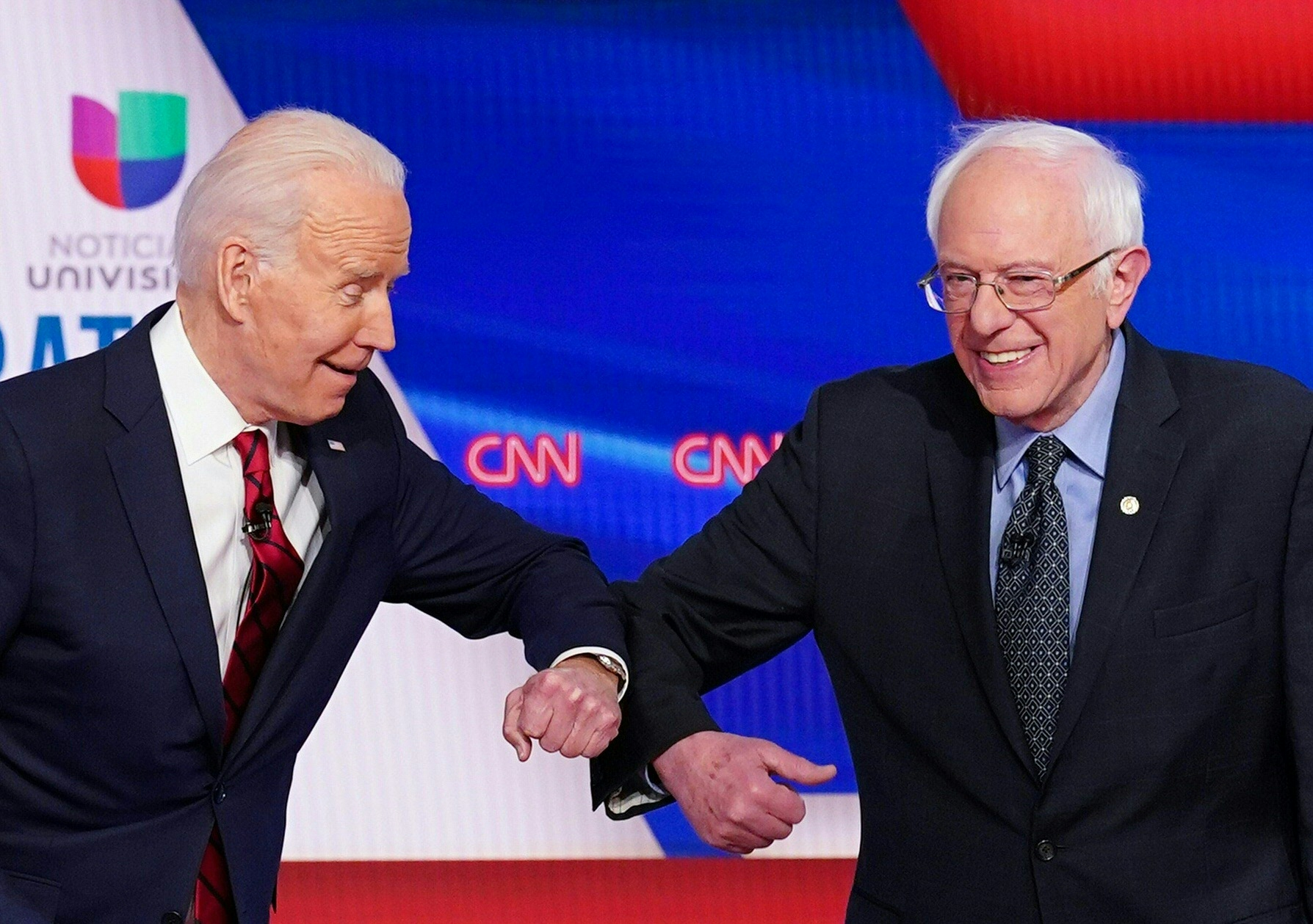 Joe Biden and Bernie Sanders greet each other with an elbow bump as they arrive for the 11th Democratic Party 2020 presidential debate in a CNN Washington Bureau studio on March 15, 2020. (MANDEL NGAN/AFP via Getty Images)
