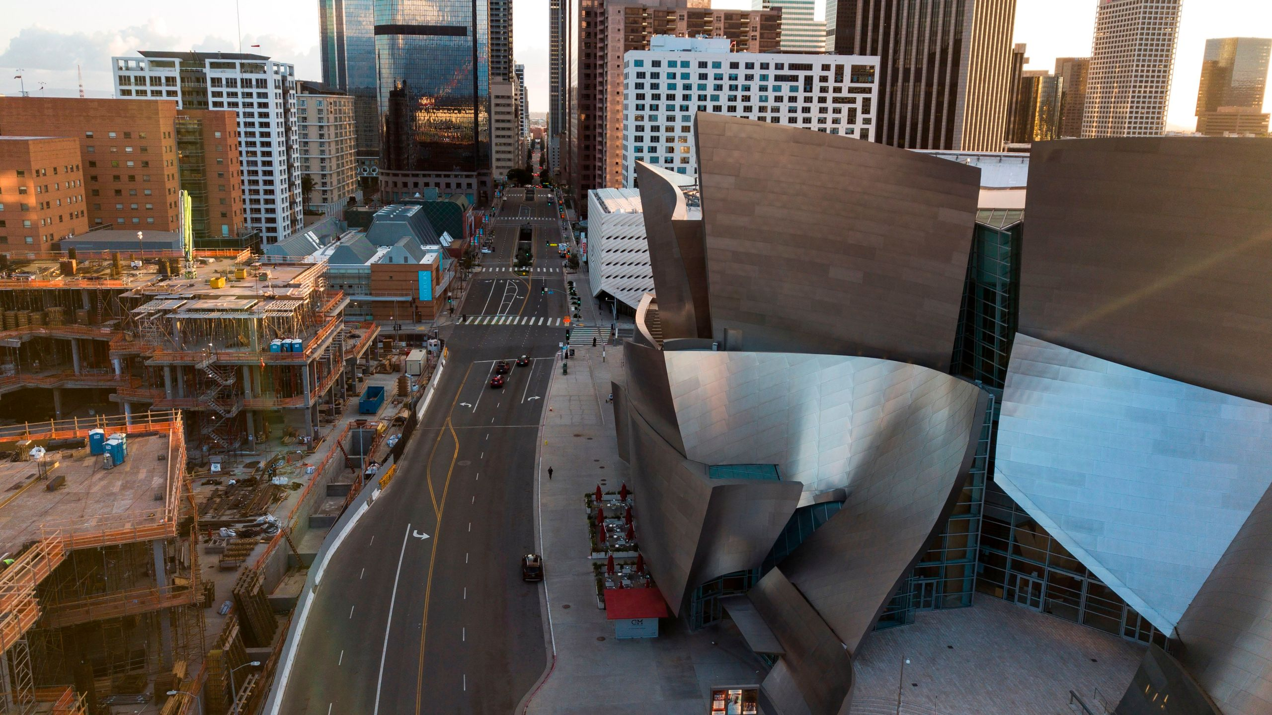 An aerial view of a deserted downtown Los Angeles looking to the south from the Walt Disney Concert Hall during evening rush hour on March 26, 2020. (ROBYN BECK/AFP via Getty Images)