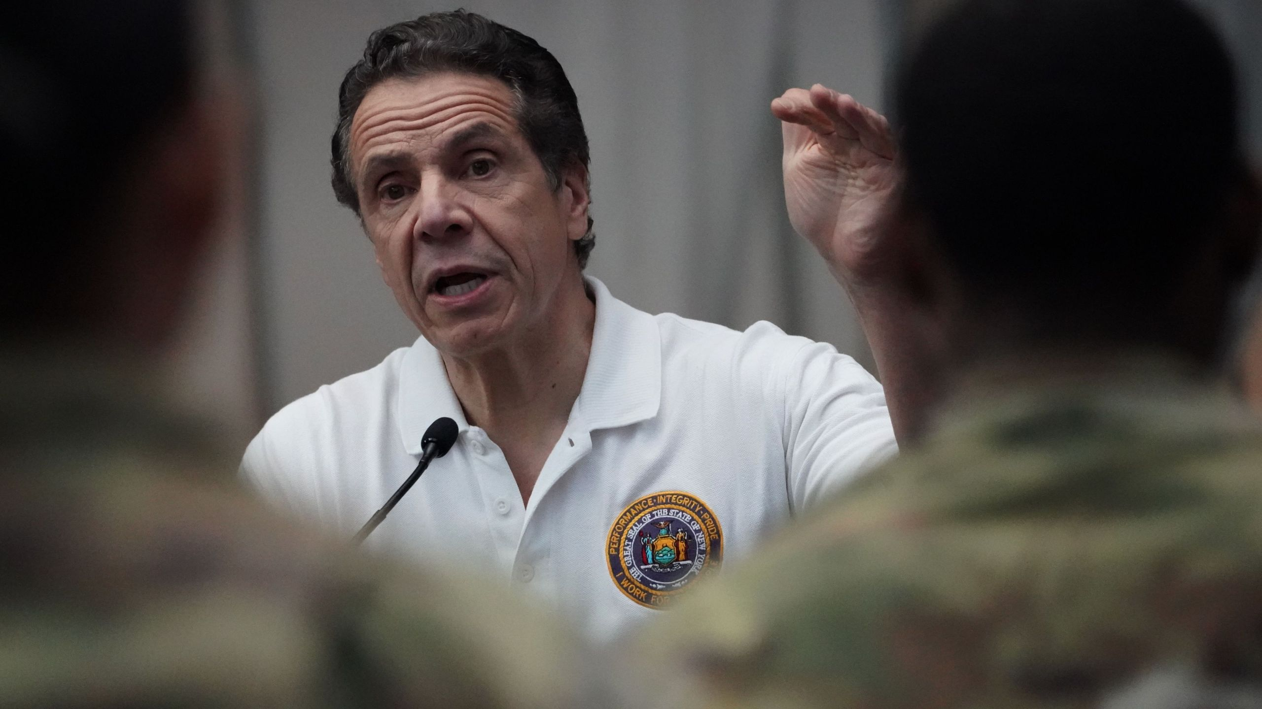 National Guard troops listen as New York Gov. Andrew Cuomo speaks to the press at the Jacob K. Javits Convention Center in New York City, on March 27, 2020. (BRYAN R. SMITH/AFP via Getty Images)
