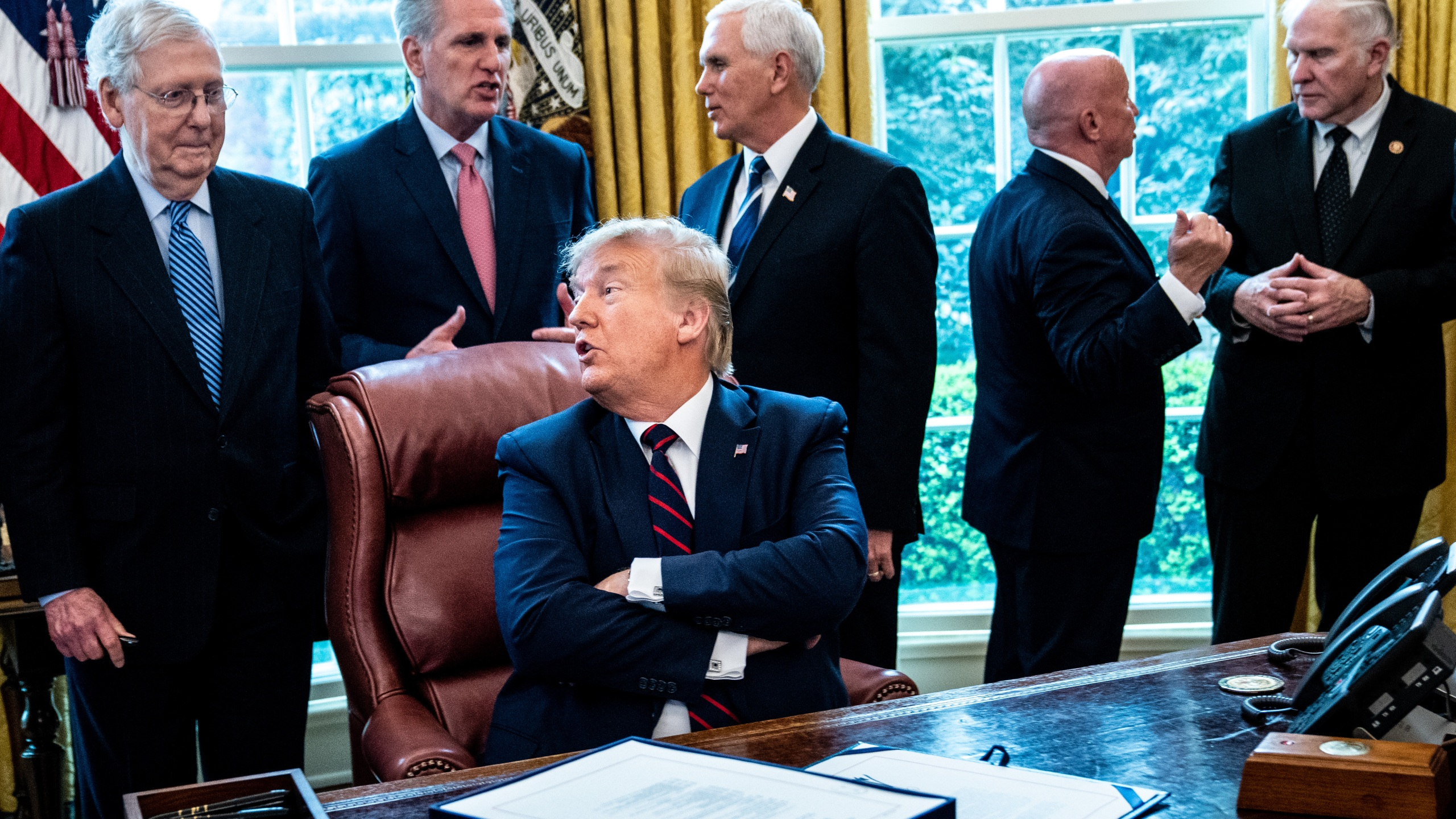 President Donald Trump speaks with Senate Majority Leader Mitch McConnell during a bill signing ceremony for the CARES Act in the Oval Office of the White House on March 27, 2020, in Washington, DC. (Erin Schaff-Pool/Getty Images)