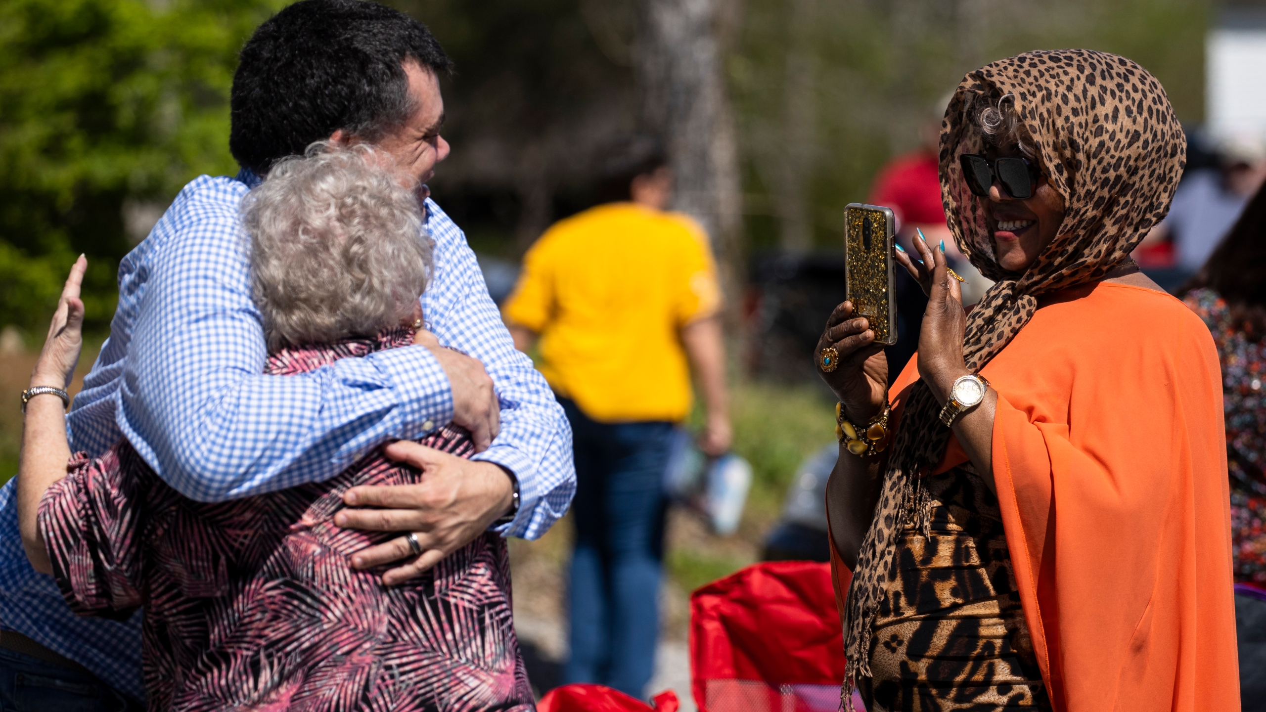 Parishioners hug after Global Vision Bible Church services held in the church parking lot on March 29, 2020, in Mount Juliet, Tenn. Gov. Bill Lee signed an executive order that prohibits social gatherings of 10 or more in response to coronavirus (COVID-19), which is also recommended by the Centers for Disease Control and Prevention. (Brett Carlsen/Getty Images)