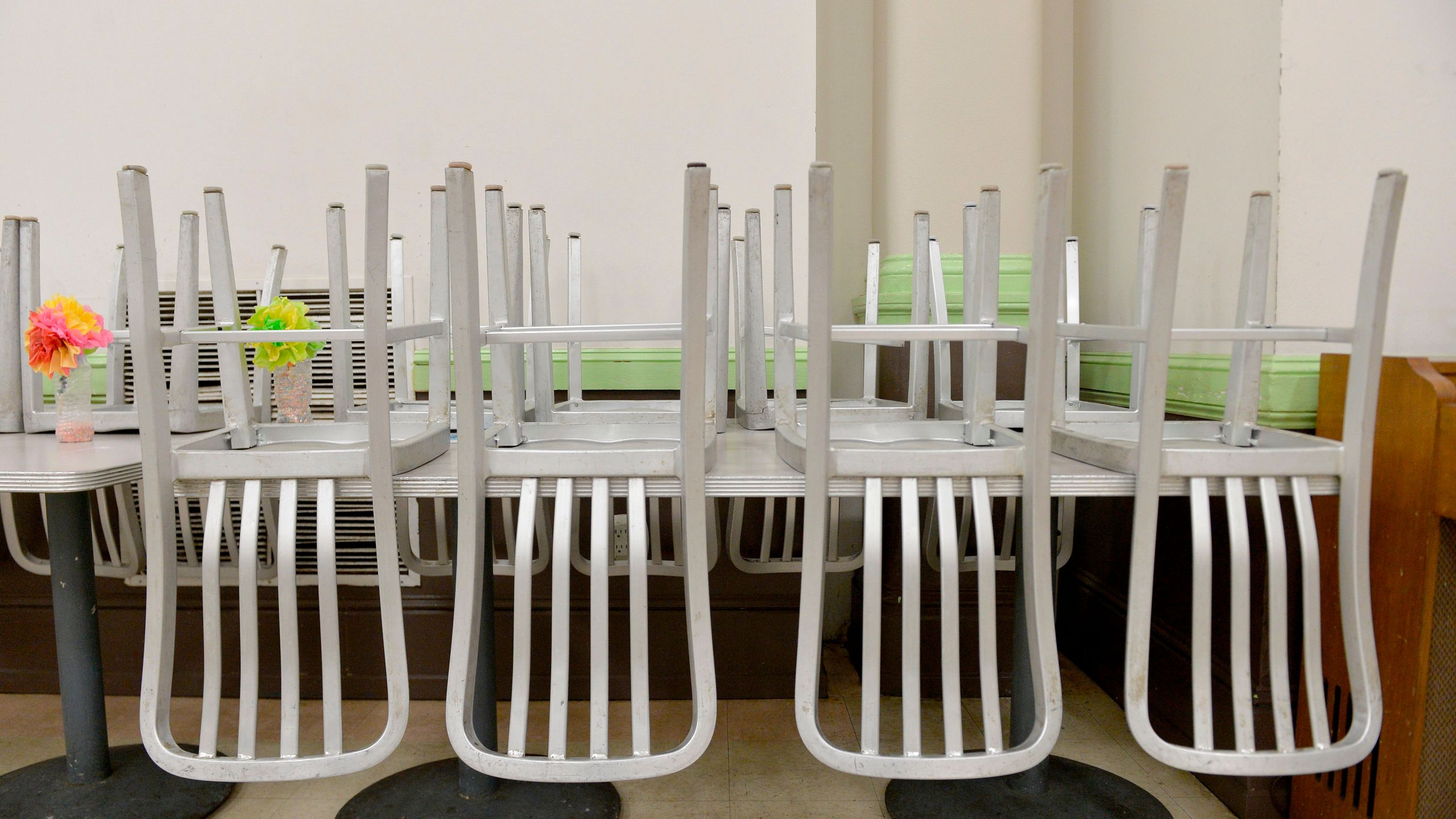 Chairs are placed on tables where guest usually eat their meals at My Brother's Table soup kitchen in Lynn, Massachusetts on March 30, 2020. (JOSEPH PREZIOSO/AFP via Getty Images)