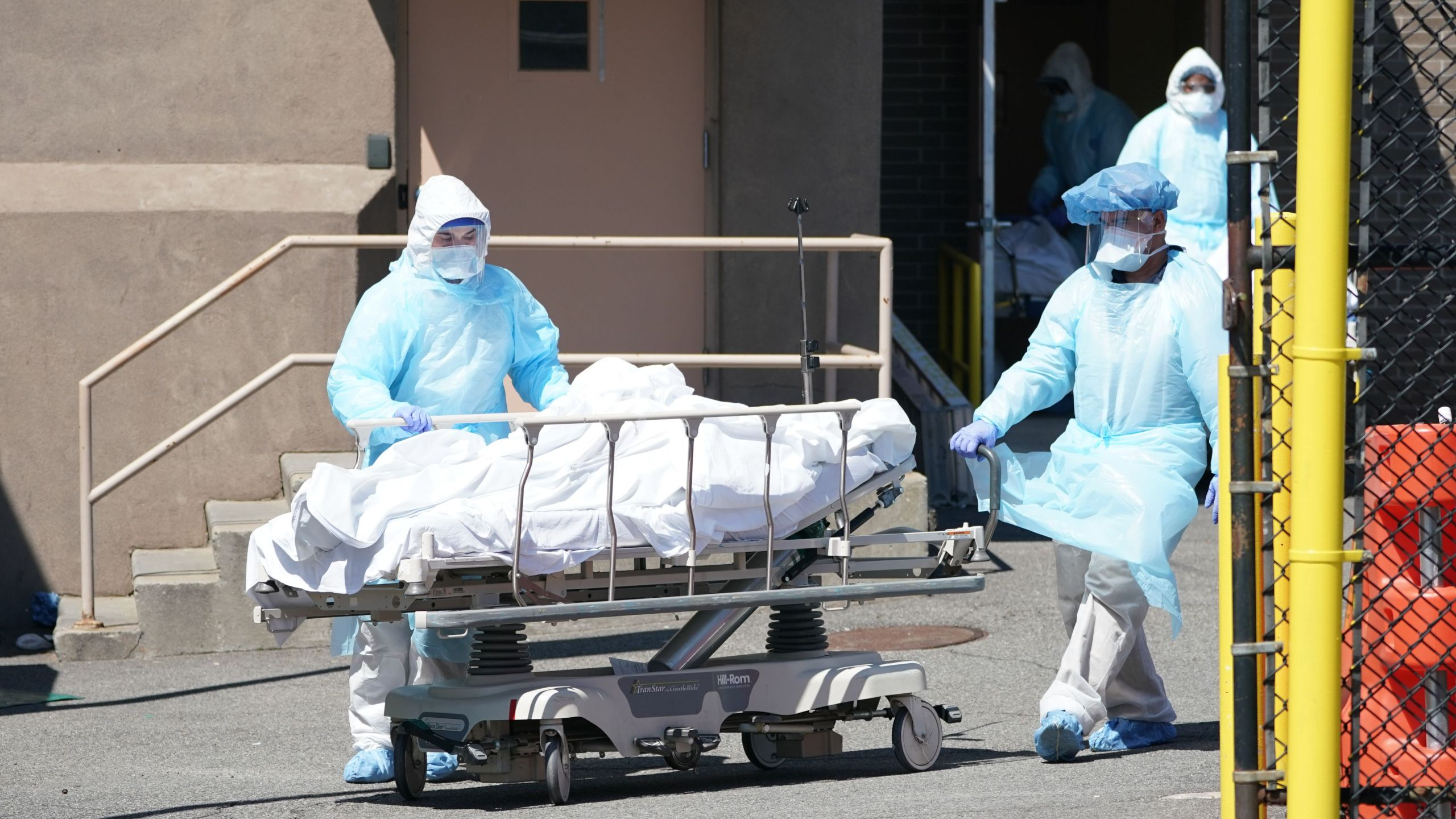 Bodies are moved to a refrigeration truck serving as a temporary morgue at Wyckoff Hospital in the Borough of Brooklyn on April 6, 2020. (BRYAN R. SMITH/AFP via Getty Images)