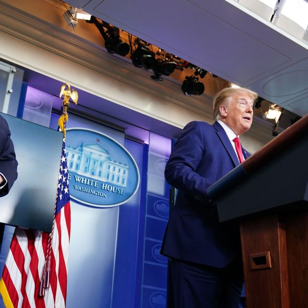 President Donald Trump speaks as Vice President Mike Pence looks on during the White House's daily briefing on the novel coronavirus on April 6, 2020. (Credit: Mandel Ngan / AFP / Getty Images)