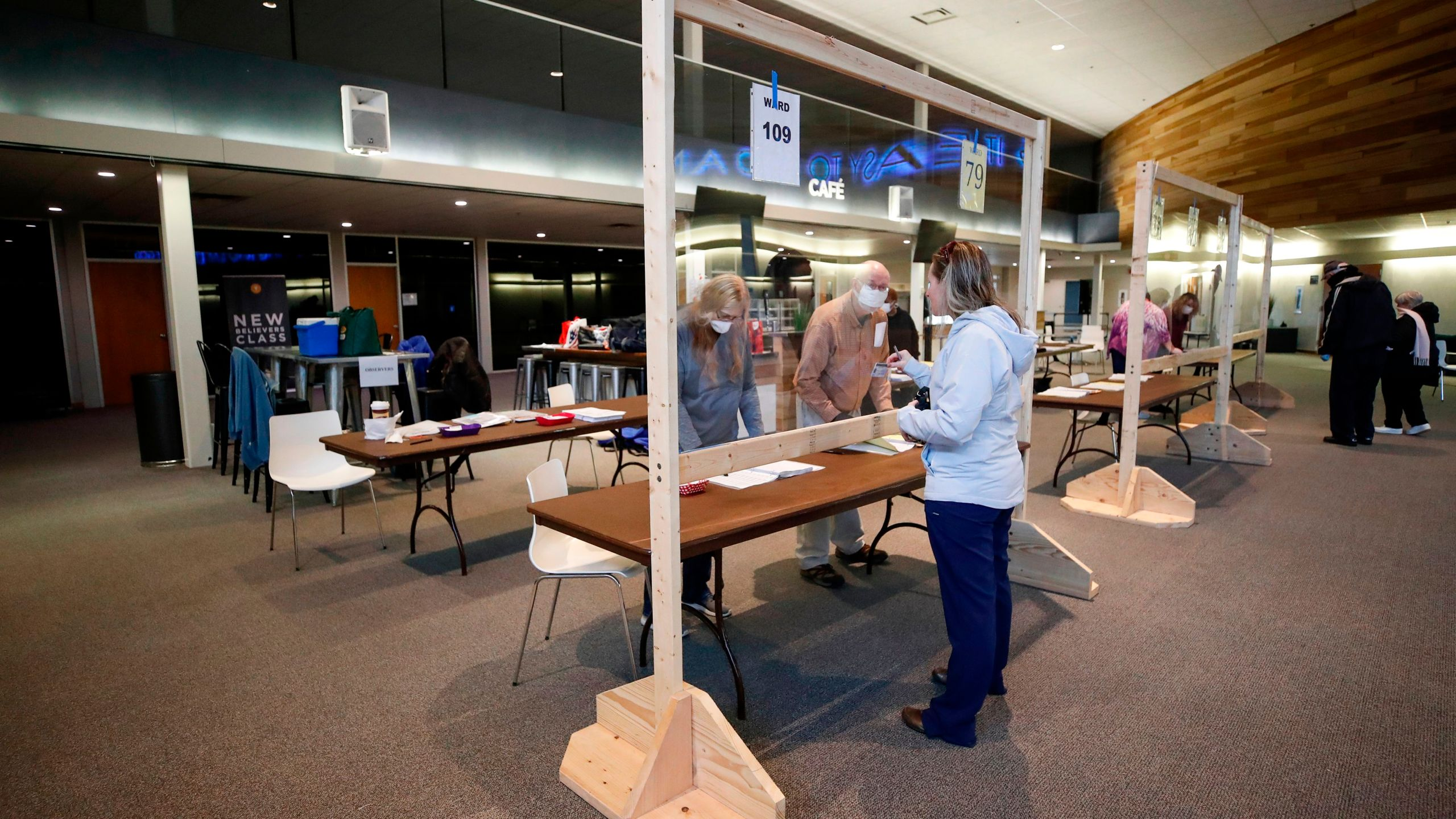 A woman checks in to cast her ballot in a presidential primary election at the Journey Church in Kenosha, Wisconsin, on April 7, 2020. (KAMIL KRZACZYNSKI/AFP via Getty Images)
