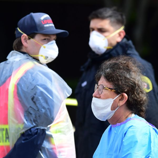 Medical and security personnel wear facemasks amid the coronavirus pandemic on the first day of COVID-19 testing at the Charles R. Drew University of Medicine in south Los Angeles on April 8, 2020. (FREDERIC J. BROWN/AFP via Getty Images)