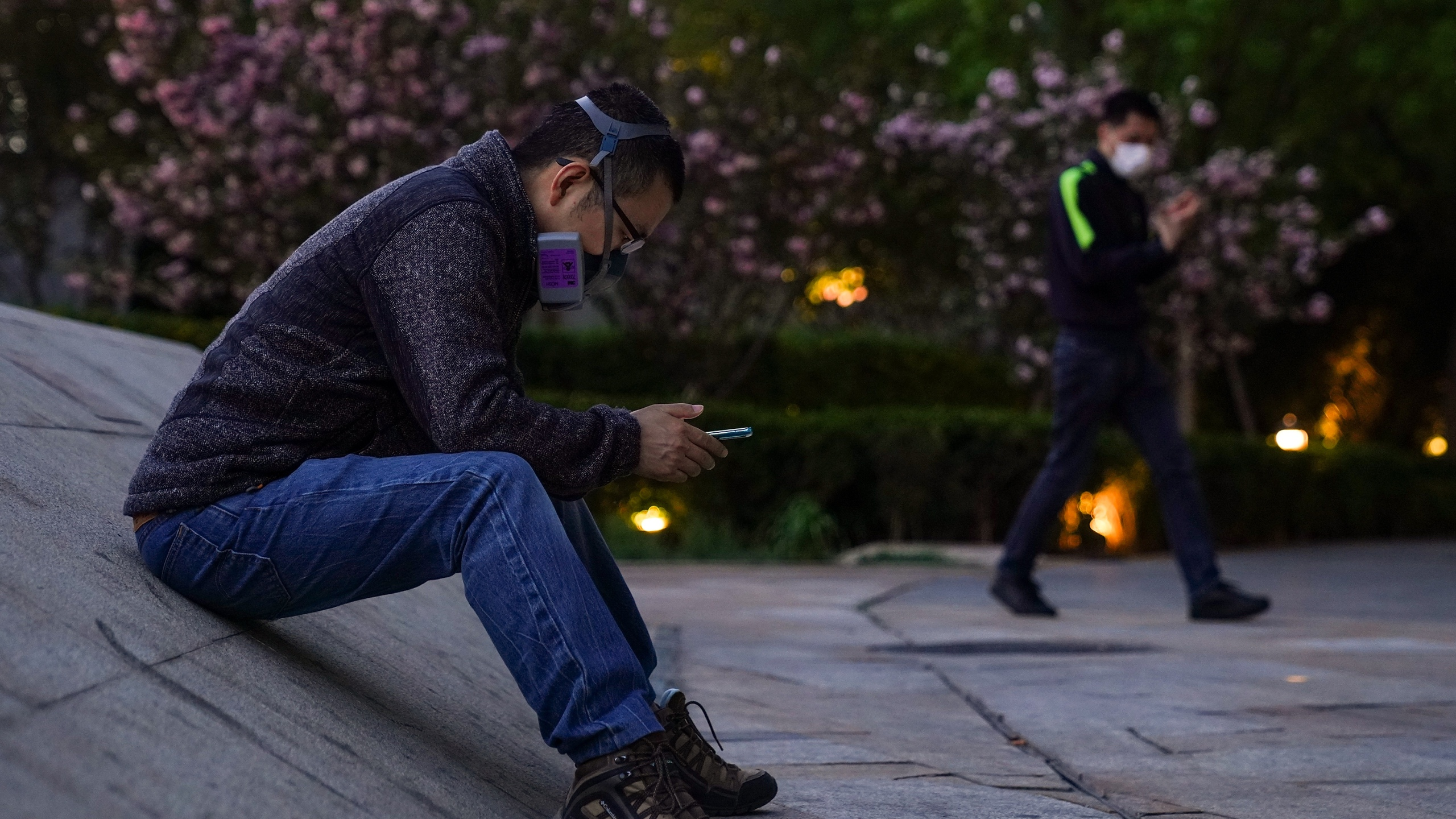 A Chinese man wears a protective mask as they he sit outside a shopping mall on April 12, 2020, in Beijing, China. (Lintao Zhang/Getty Images)
