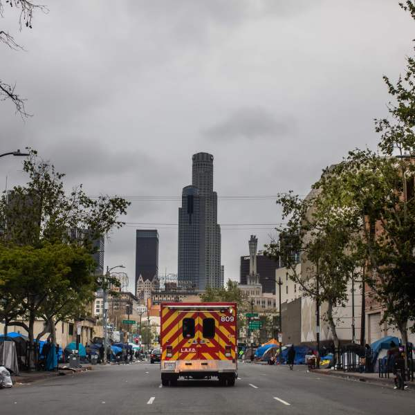 A Los Angeles Fire Department ambulance travels on Skid Row on April 12, 2020 in downtown Los Angele. (APU GOMES/AFP via Getty Images)