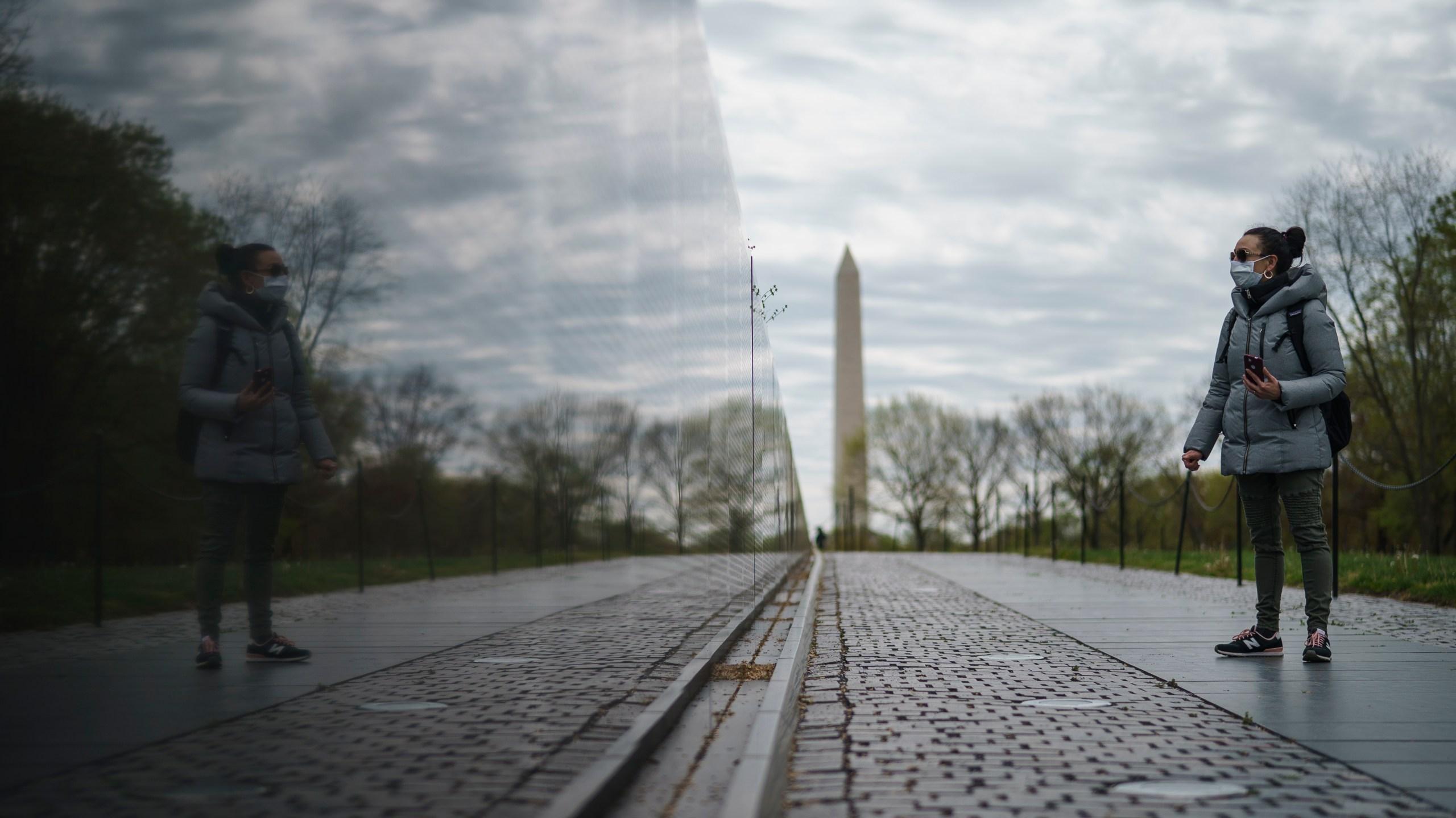 A woman visits an empty Vietnam Veterans Memorial on April 14, 2020, in Washington, D.C. (Drew Angerer/Getty Images)