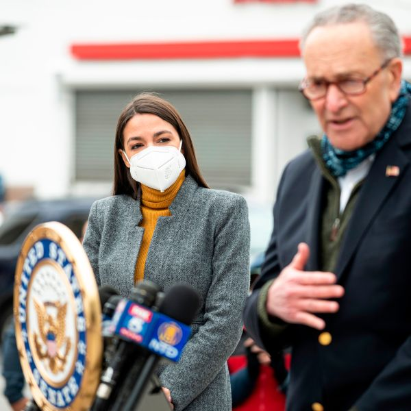 Senate Minority Leader Chuck Schumer speaks as Congresswoman Alexandria Ocasio-Cortez listens during a press conference in the Corona neighborhood of Queens on April 14, 2020. (JOHANNES EISELE/AFP via Getty Images)