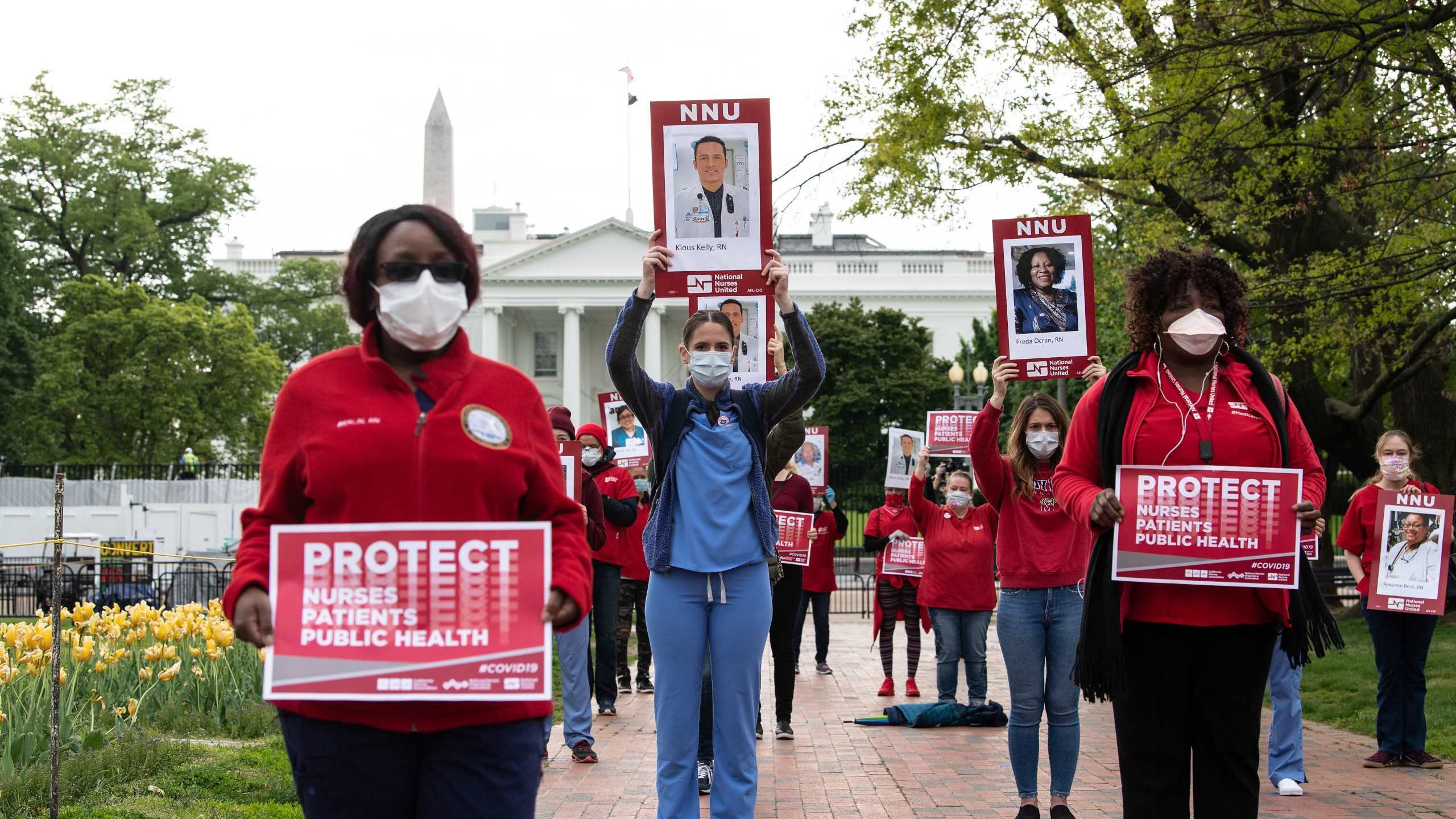 Nurses protest outside the White House against their lack of personal protection equipment on April 21, 2020. (Credit: NICHOLAS KAMM / AFP / Getty Images)