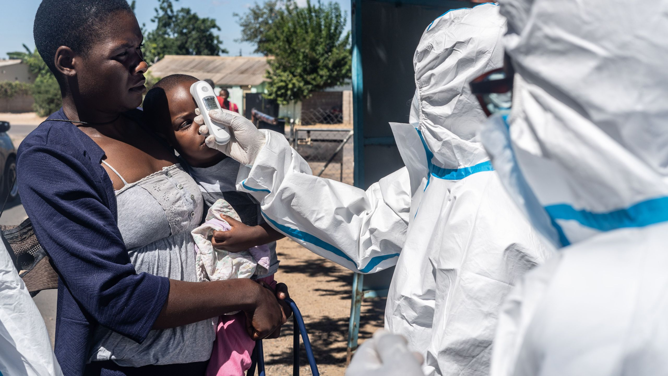 Medical personnel check temperatures of patients visiting Mpilo Hospital in Bulawayo, Zimbabwe on April 25, 2020. The number of cases of coronavirus in Africa is currently low compared to the rest of the planet: nearly 28,000 on the continent against more than 2.7 million worldwide, according to an AFP count. (ZINYANGE AUNTONY/AFP via Getty Images)