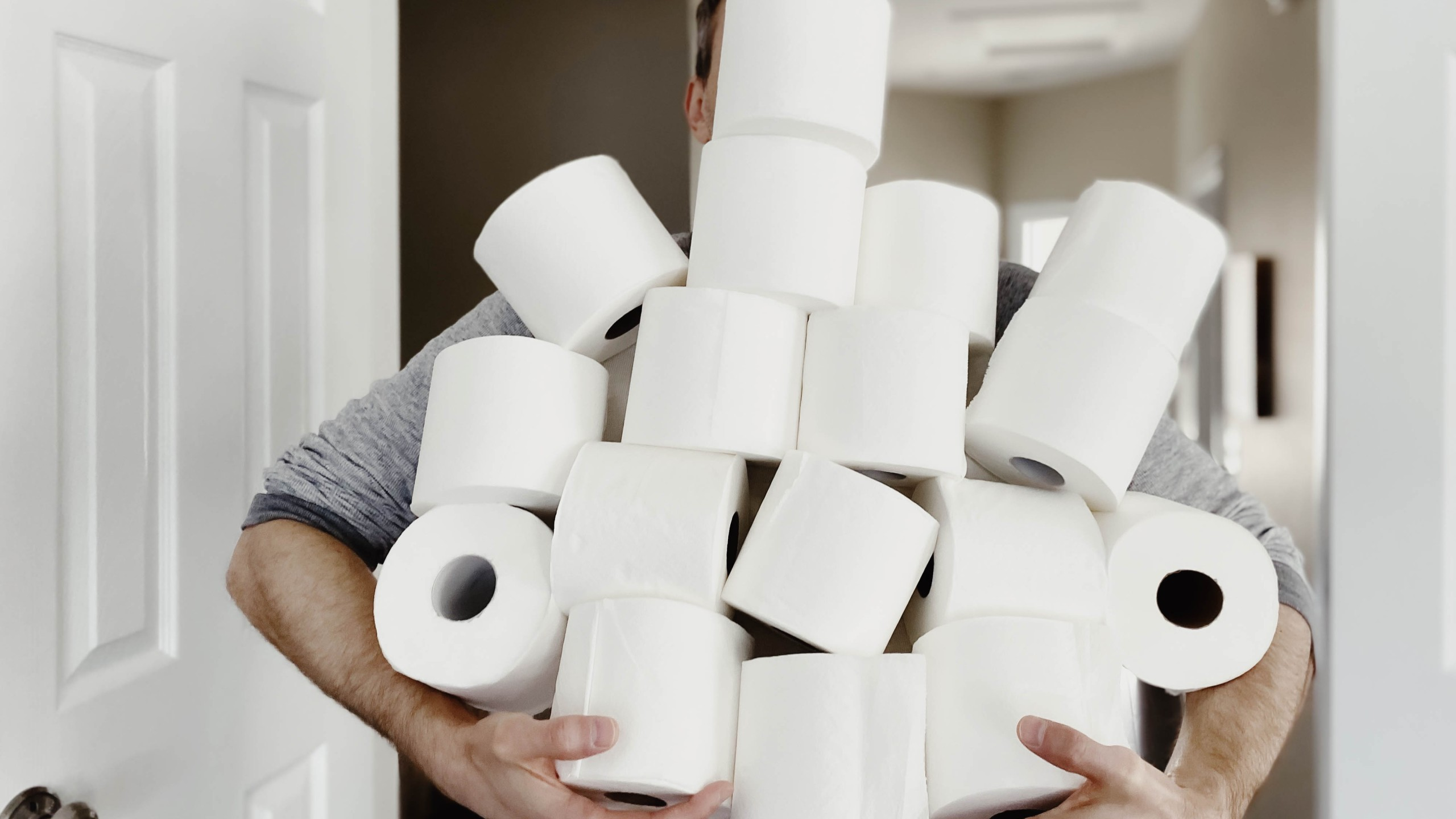 A man carries an abundance of toilet paper in this undated file photo. (Credit: Getty Images)