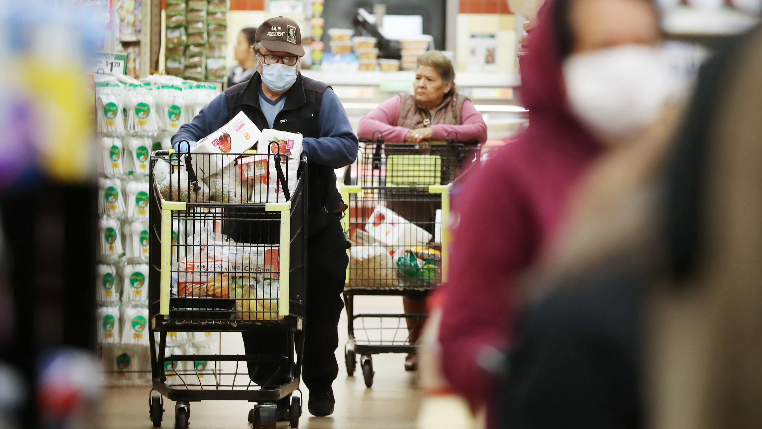 Seniors shop for groceries during special hours open to seniors and the disabled only at Northgate Gonzalez Market on March 19, 2020, in Los Angeles. (Mario Tama/Getty Images)