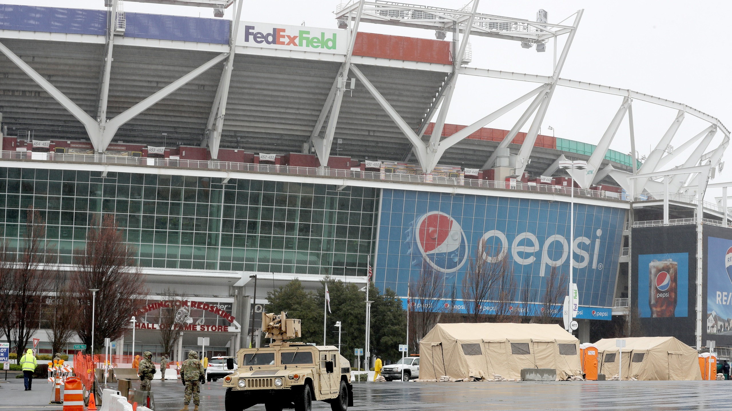 Tents, vehicles and other equipment from the Maryland National Guard occupy a section of parking lot on the south side of FedEX Field, home of the Washington Redskins, that officials said will become a clinic for health screenings in response to the global coronavirus pandemic March 23, 2020 in Landover, Maryland. (Chip Somodevilla/Getty Images)