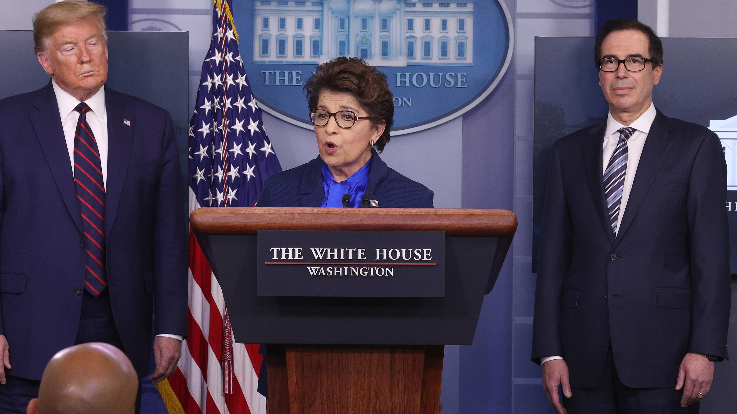 Small Business Administrator Jovita Carranza speaks while flanked by U.S. President Donald Trump and Secretary of Treasury Steve Mnuchin in the press briefing room with members of the White House Coronavirus Task Force on April 2, 2020 in Washington, D.C. (Win McNamee/Getty Images)