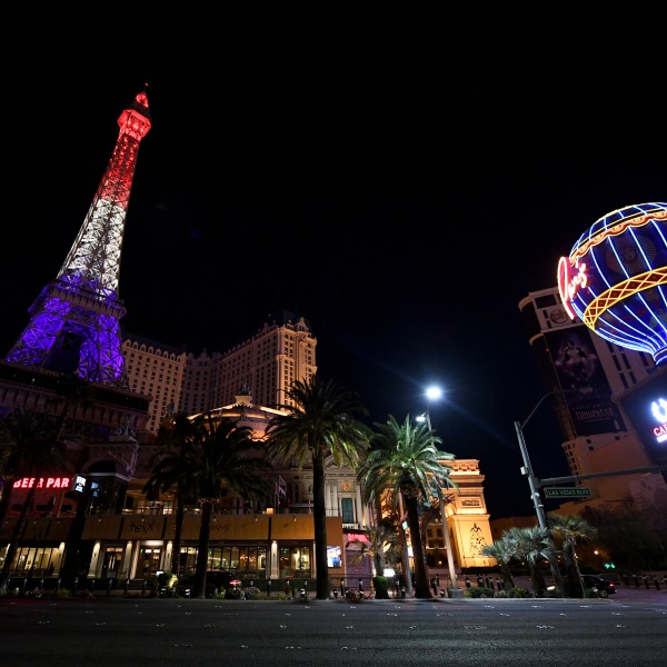 The 50-story replica Eiffel Tower at the shuttered Paris Las Vegas on the Las Vegas Strip is lit up in red, white and blue colors, in tandem with the Eiffel Tower in Paris, France, to honor healthcare workers fighting the continuing spread of the coronavirus on April 3, 2020, in Las Vegas, Nevada. (Ethan Miller/Getty Images)