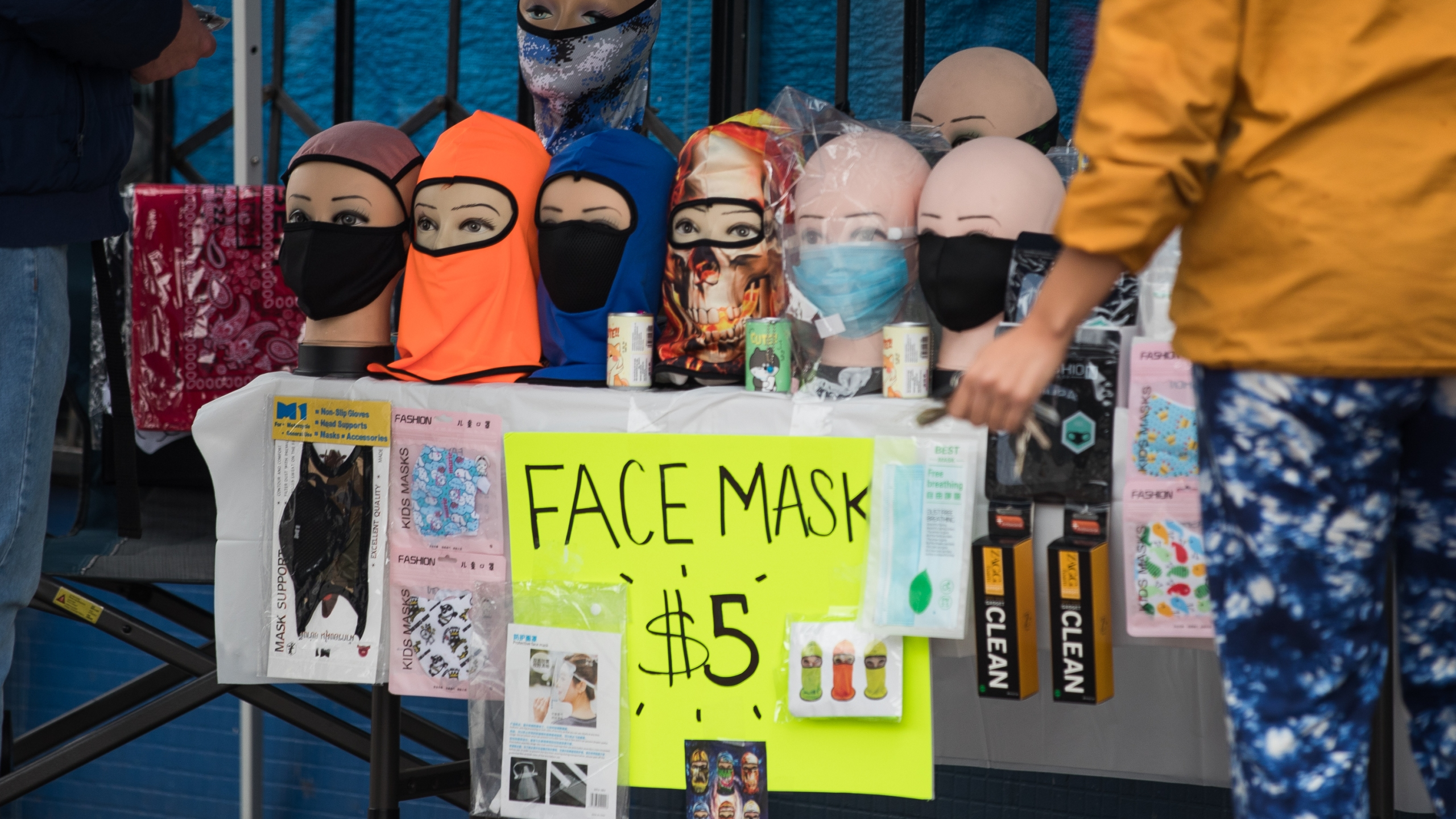 A vendor sells face masks on the sidewalk during the coronavirus pandemic on April 08, 2020, in Los Angeles. (Rich Fury/Getty Images)