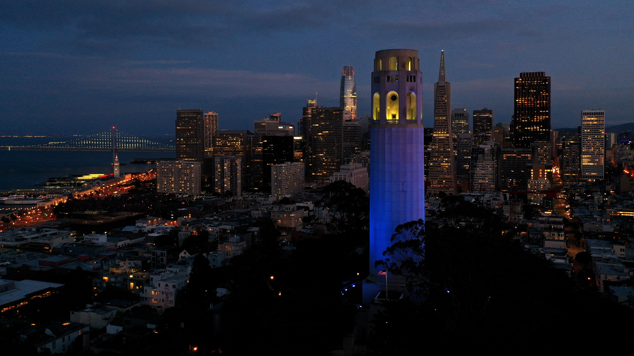 Coit Tower is lit up blue on April 9, 2020 in San Francisco. Landmarks and buildings across the nation are displaying blue lights to show support for health care workers and first responders on the front lines of the COVID-19 pandemic. (Justin Sullivan/Getty Images)