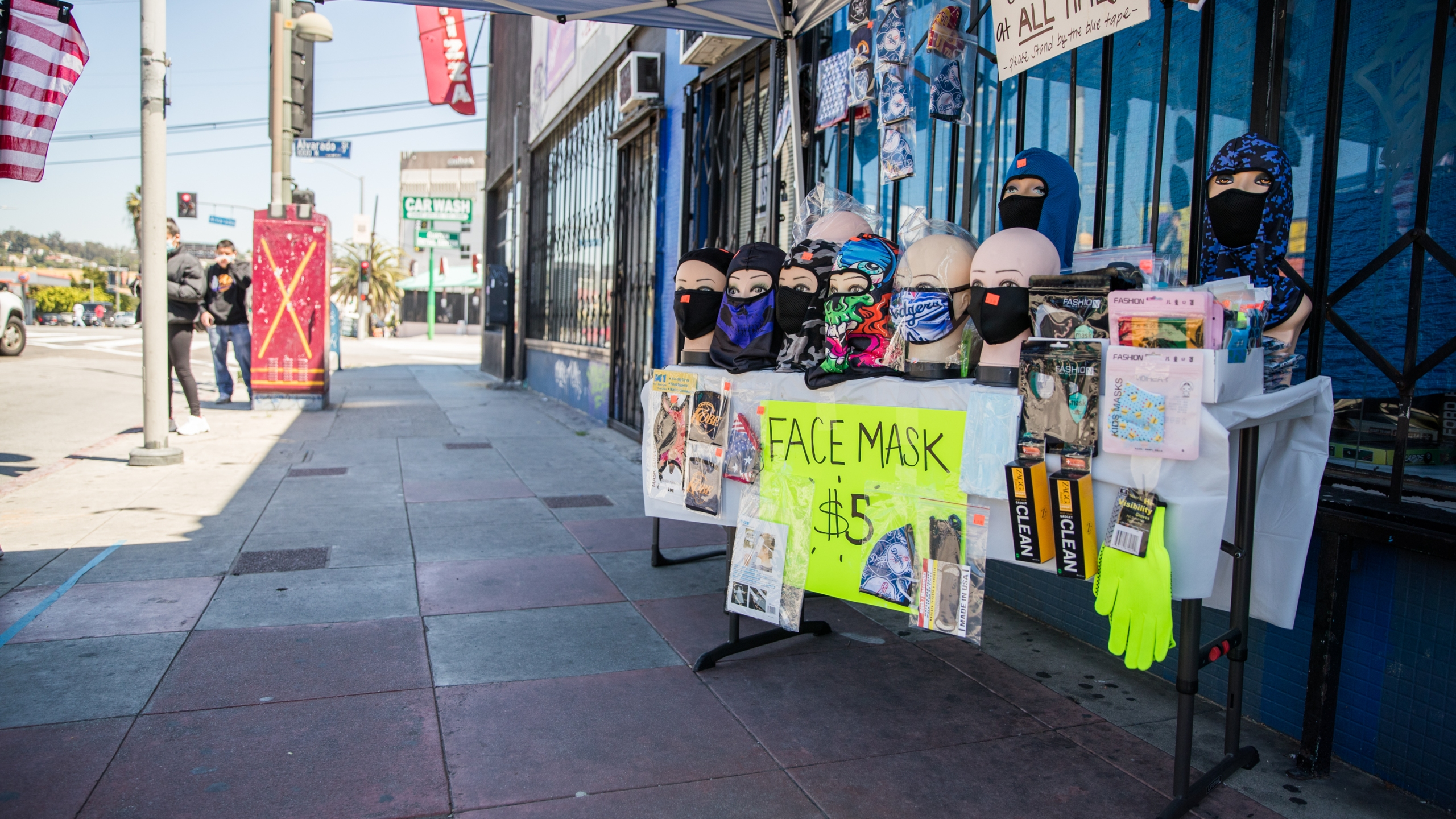 A street vendor sells face masks from a pop up stand on April 15, 2020, in Los Angeles, California. (Rich Fury/Getty Images)