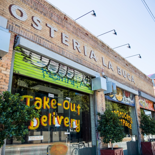 The storefront of restaurant Osteria La Buca in Los Angeles is seen on April 15, 2020. (Credit: Rich Fury / Getty Images)