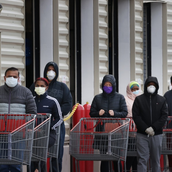 Customers wear face masks to prevent the spread of the novel coronavirus as they line up to enter a Costco Wholesale store April 16, 2020 in Wheaton, Maryland. (Chip Somodevilla/Getty Images)
