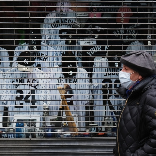Jerseys of famous New York Yankees baseball players are displayed in the window of a shuttered business as the coronavirus keeps businesses mostly closed on April 20, 2020, in New York City. (Credit: by Spencer Platt / Getty Images)